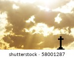 Silhouette Of A Cross In Beams...
