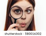 funny woman close up looks at... | Shutterstock . vector #580016302