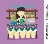asian owner of flower shop...