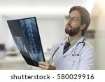 male doctor in his office... | Shutterstock . vector #580029916