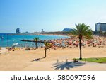 view of barcelona beach on a... | Shutterstock . vector #580097596