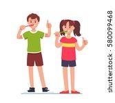 happy girl   boy brushing their ... | Shutterstock .eps vector #580099468