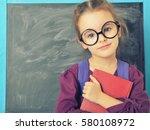 cute little girl standing near... | Shutterstock . vector #580108972