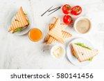 breakfast with club sandwiches... | Shutterstock . vector #580141456