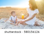 mother and her son on holiday... | Shutterstock . vector #580156126