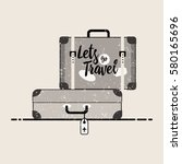 retro suitcase with buckles.... | Shutterstock .eps vector #580165696