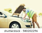 car breakdown. young man is... | Shutterstock . vector #580202296