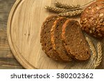 fresh fragrant bread on a round ... | Shutterstock . vector #580202362