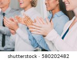 closeup of four smiling... | Shutterstock . vector #580202482
