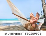 happy couple family in hammock... | Shutterstock . vector #580209976