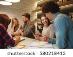 group of friends working on a... | Shutterstock . vector #580218412