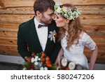 bride and groom kissing on... | Shutterstock . vector #580247206