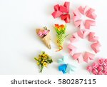 Small photo of Happy International Women's Day celebrate on March 8, congratulatory CARD. rose-color paper hearts shape figure eight 8 on white background