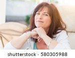 attractive middle aged woman... | Shutterstock . vector #580305988