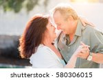 happy middle aged couple enjoy... | Shutterstock . vector #580306015