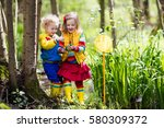 children playing outdoors.... | Shutterstock . vector #580309372