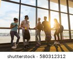 young people group in airport... | Shutterstock . vector #580312312