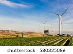 a wind farm under the morning... | Shutterstock . vector #580325086