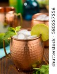 moscow mule with lime and mint. ... | Shutterstock . vector #580337356