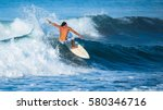 riding the waves. costa rica ... | Shutterstock . vector #580346716