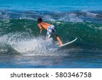 riding the waves. costa rica ... | Shutterstock . vector #580346758
