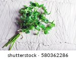 parsley on a slate background | Shutterstock . vector #580362286