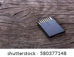 sd card on an old wooden table  ...