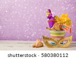 purim holiday concept with... | Shutterstock . vector #580380112