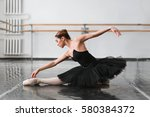 female ballet dancer posin on... | Shutterstock . vector #580384372
