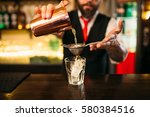 barman flaring behind bar... | Shutterstock . vector #580384516