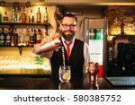 bartender is making alcohol... | Shutterstock . vector #580385752