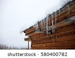 winter icicles hanging on... | Shutterstock . vector #580400782
