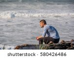 lone man at beach  autumn. usa... | Shutterstock . vector #580426486