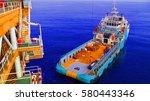 supply boat transfer cargo to... | Shutterstock . vector #580443346