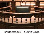Small photo of A witness stand with a black seat