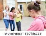 unhappy girl being gossiped... | Shutterstock . vector #580456186