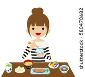 young woman eating japanese... | Shutterstock .eps vector #580470682