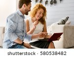 concentrated couple working... | Shutterstock . vector #580538482