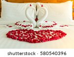 rose petals on white bed at ... | Shutterstock . vector #580540396