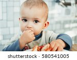 baby eats a pomegranate  ripe... | Shutterstock . vector #580541005