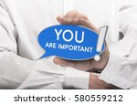 hand holding a blue bubble... | Shutterstock . vector #580559212