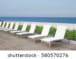 white beach bed on timber deck... | Shutterstock . vector #580570276