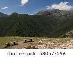two benches overlooking the... | Shutterstock . vector #580577596