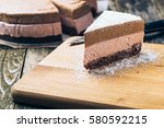 piece of chocolate mousse cake... | Shutterstock . vector #580592215