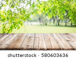 empty wooden table with garden... | Shutterstock . vector #580603636