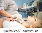 ultrasound device  the doctor... | Shutterstock . vector #580609312