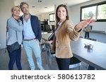 real estate agent presenting... | Shutterstock . vector #580613782