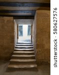 Small photo of Cairo, Egypt - February 4 2017: Aged narrow dark vaulted passage and staircase leading to outdoor small lobby with two yellow wooden windows at the Soliman Agha El-Selehdar complex, Medieval Cairo