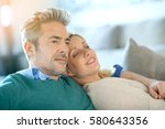 middle aged couple relaxing... | Shutterstock . vector #580643356