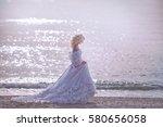 bride walking along sea coast | Shutterstock . vector #580656058